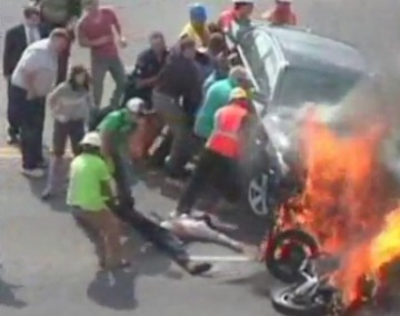 Bystanders-Lift-Burning-Car-To-Save-Motorcyclist