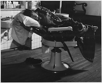 Some_people_preferred_to_sleep_in_barber_charirs,_paying_$1.50_a_night_for_the_priviledge,_or_spend_the_night_in_the..._-_NARA_-_196406